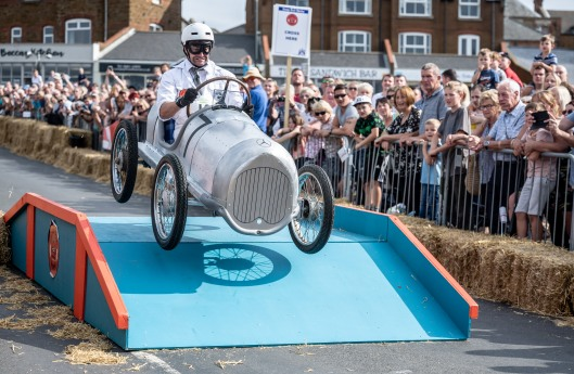 Soapbox racer going over the ramp on the track