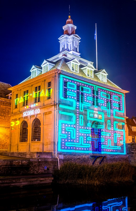 A light projection of pacman on the Custom House