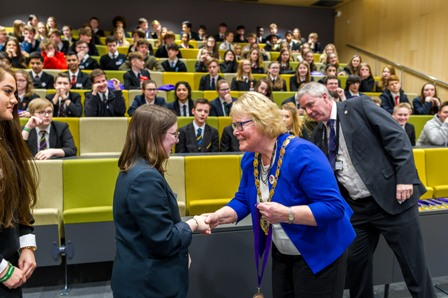Cllr Carol Bower presents a student with a certificate at the West Norfolk University Challenge Conference 2018