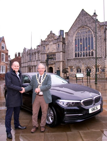 The Mayor, Cllr Geoff Hipperson takes the new car from Richard Atkins from Listers King's Lynn.