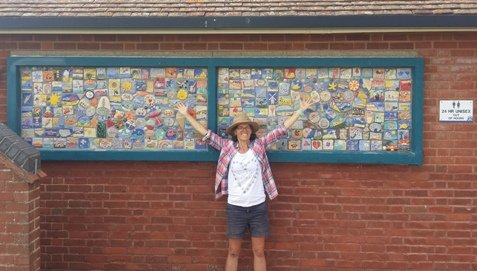 Artist Kate Dunbar with painted ceramic tiles at Hunstanton Heritage Garden toilets.