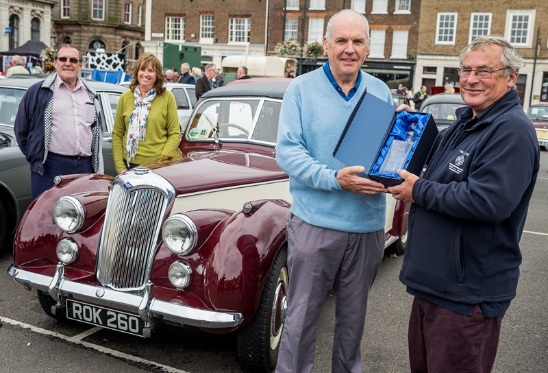 Cllr Nick Daubney presents Chris King with the Les Daubney Car of the Show award on Sunday 10 September 2017, watched by Cllr Chris Crofts and Hilary King.