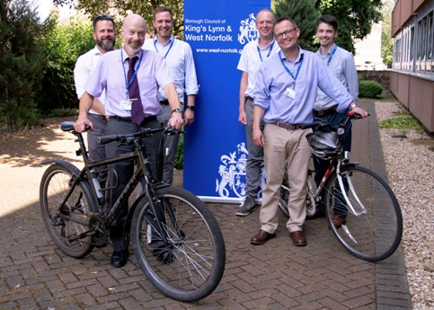 Picture of Ray Harding with the bike relay team from the borough council.