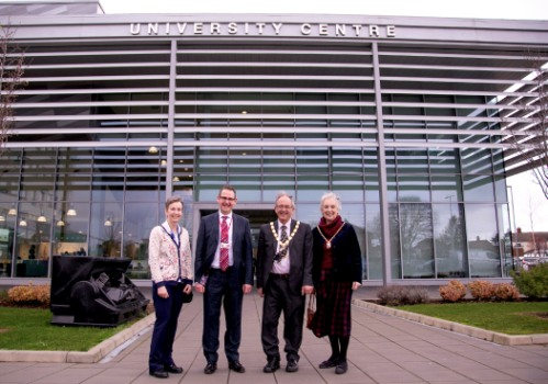 Jenny Rouse from the borough council, standing next to David Pomfret from COWA, next to the Mayor & Mayoress outside the University Campus at the COWA.