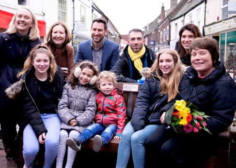 Picture of Antonio's bench featuring Titina, Antonio's widow and her family. Also Cllr Elizabeth Nockolds.