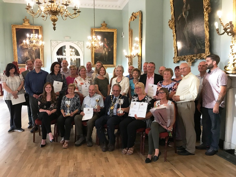 The winners of the Allotment Awards 2018 posing in the town hall with their prizes