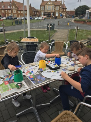 A picture of children participating in the art on the green event