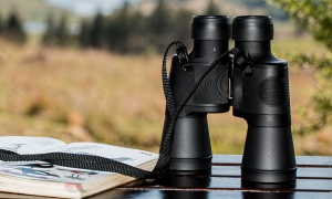 An image of a pair of binoculars on a table
