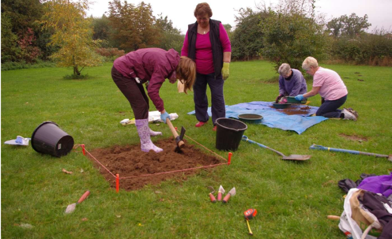 Cllr Nockolds excavates a test pit in a field