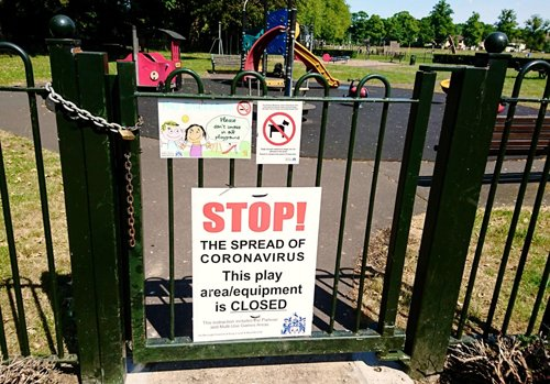 Picture of a closed play area. Sign says: Stop, do not enter.
