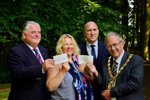 Picture of the cheque presentation at Mintlyn Crem.