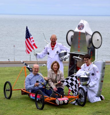 Andrew Searle & Cllr Nockolds sit next to Patrick & Oliver Richardsons rocket soap box.