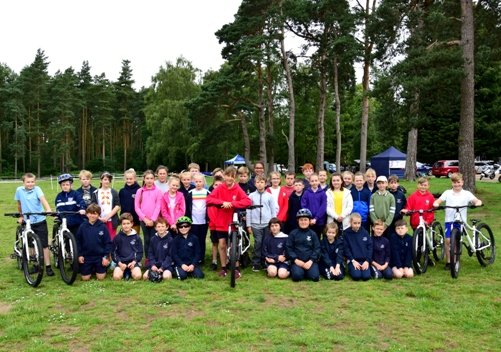 School children from the Smithdon cluster get ready to get on their bikes around the course at Sandringham