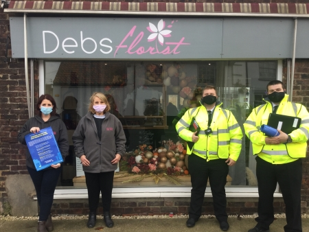 Picture of Ellie & Loretta Cooper in front of Debs Florist with 2 Covid marshalls.