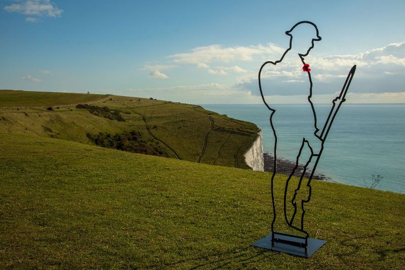 A tommy statue on the cliff at Dover
