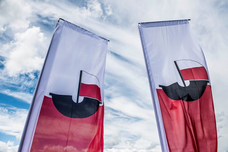 Two Hanse flags against a cloudy sky