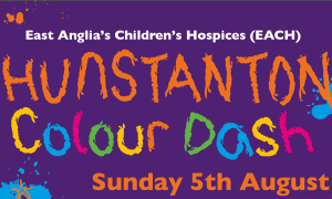 An banner with the words Hunstanton Colour Dash on it, advertising the event on 5 August