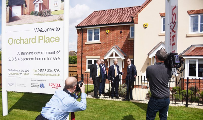 Cllr Alistair Beales, Cllr Brian Long, Henry Bellingham MP and Dominic Raab, Housing Minister having their photograph taken in front of one of our new-build homes in Orchard Place.