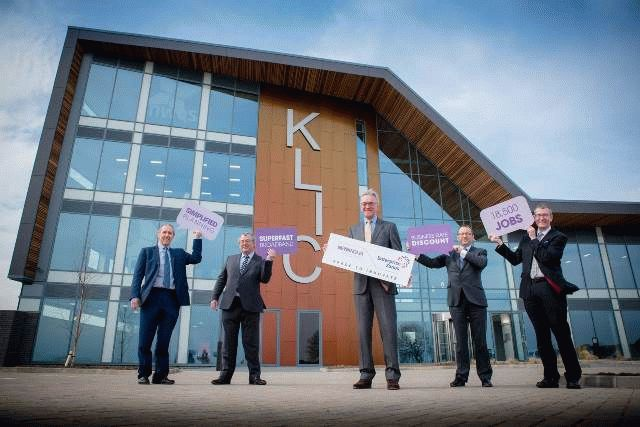 Mark Pendlington, Cllr Daubney, Mark Reavell and others pose in front of the new KLIC building