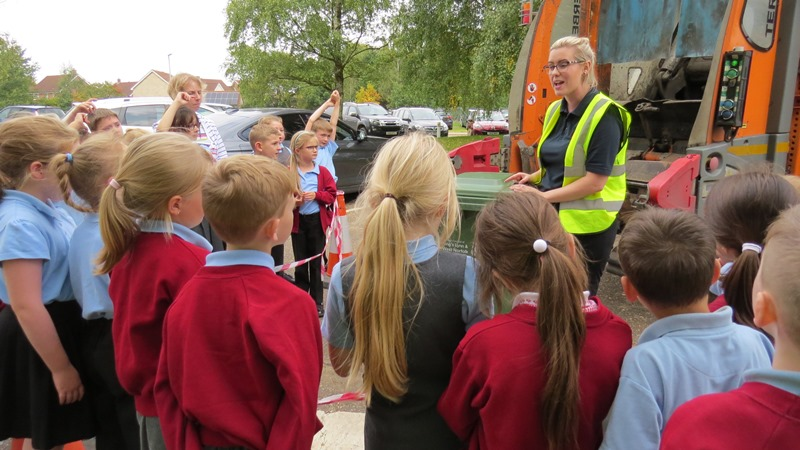 Katie Shaw, contract supervisor for Kier, talks about recycling to a group of schoolchildren, in front of a bin lorry