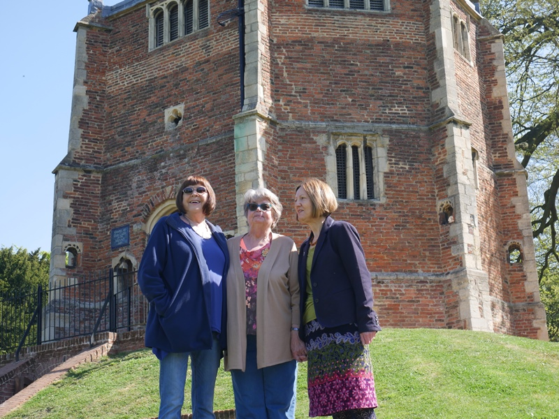 Lorraine Burton, Janice McMillan and Cllr Elizabeth Nockolds standing outside the Red Mount Chapel on a sunny day.