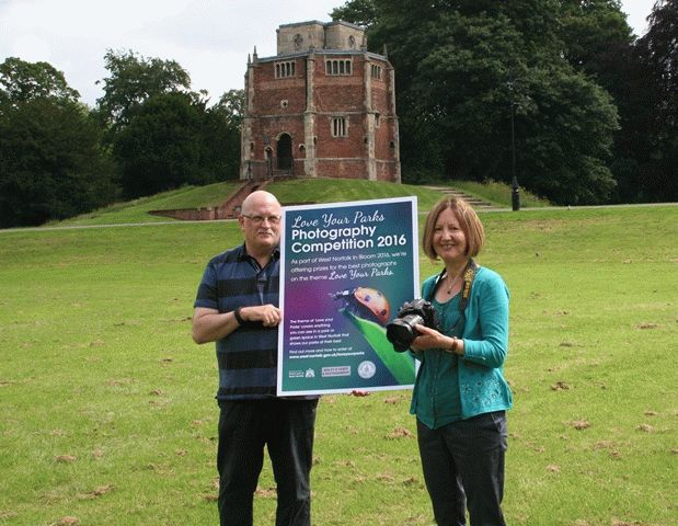 Cllr Elizabeth Nockolds and Mike Myers of the King's Lynn & District Camera Club launch the competition in The Walks, in front of the Red Mount
