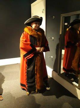 A child dressed in mayoral robes at Stories of Lynn