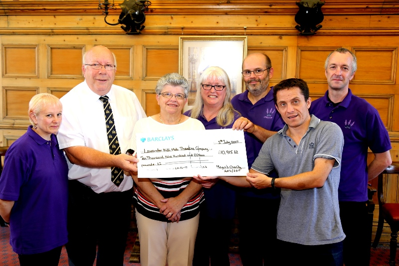 Cllr Whitby presents a cheque to the Lavender Hill Mob Theatre Company