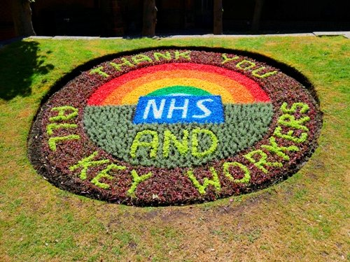 Picture of the badge bed in Tower Gardens. It says Thank you NHS and all key workers.
