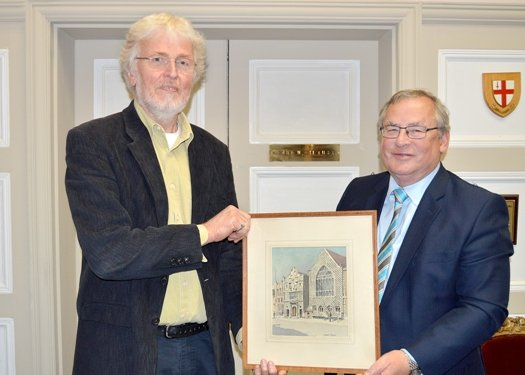 The Mayor accepts the water colour painting from Phil Barrett.