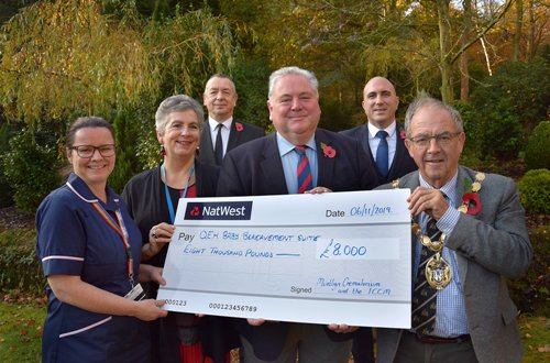Cllr Kunes & the Mayor hand over a cheque to QE Hospital representatives.