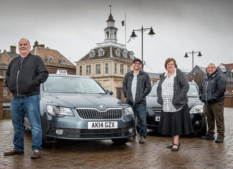 Jim Nolan, Terry Thorn, Teresa Shepperson and Gary Greenacre standing in front of a taxi parked in front of the Custom House
