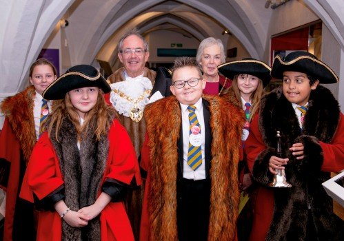 Students dressed as the Mayor with the Mayor at Stories of Lynn.