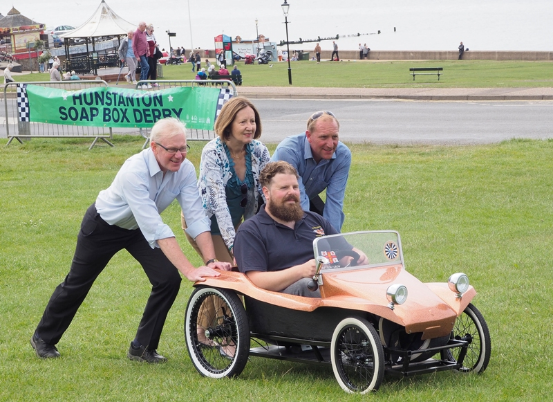 Cllr Nockolds, Roger Partridge, Chris Durham push 2017 winner Ed Napolitano in his kart on The Green in Hunstanton