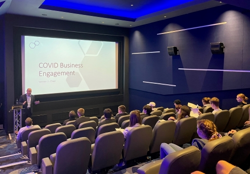 Students receiving Covid-marshall training at the Corn Exchange cinema.