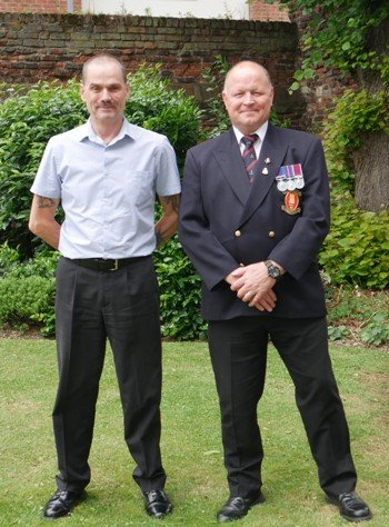 Nathan Johnson & John Hussey stand in their uniforms in the council garden.