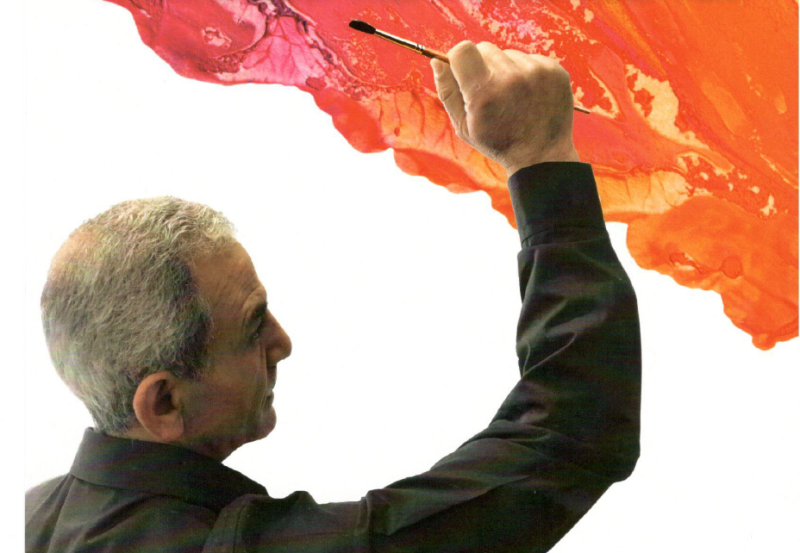 artist ali atrissi pictured holding up a paintbrush
