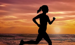 An image of a runner on the beach at sunset