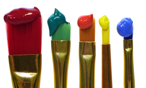An image of five paint brushes loaded with paint