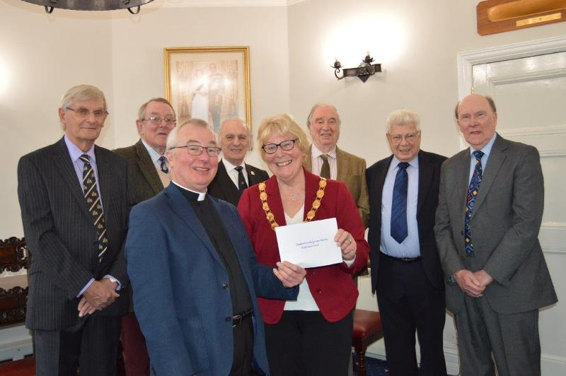 Cllrs Manning, Sampson, Ayres, Bower and Honorary aldermen Howling, Walters, and Benefer present a cheque to Canon Ivory.