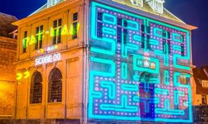 A light projection of a Pac-Man on the Custom House in King's Lynn