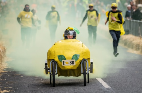 A picture of a Soap Box Derby kart in the shape of a lemon taking part in the Searles Soap Box Derby 2018