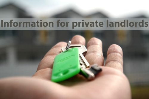 Hand holding house keys with information for private landlords written above it.