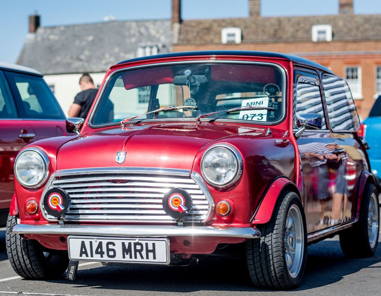 A red classic mini parked on the Tuesday Market Place in King's Lynn