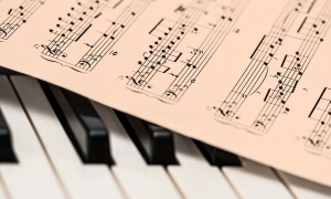An image of a music sheet laying on a piano