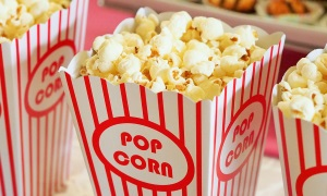 An image of cinema style popcorn in a red and white striped box