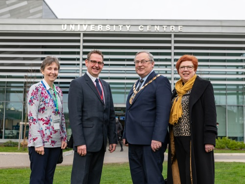 An image of the Mayor of King's Lynn & West Norfolk standing with staff from the Borough Council of King's Lynn & West Norfolk and the College of West Anglia standing outside the University Centre at the College of West Anglia