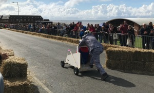 An image of a soap box cart driving along the course during the Soap Box Derby event in Hunstanton