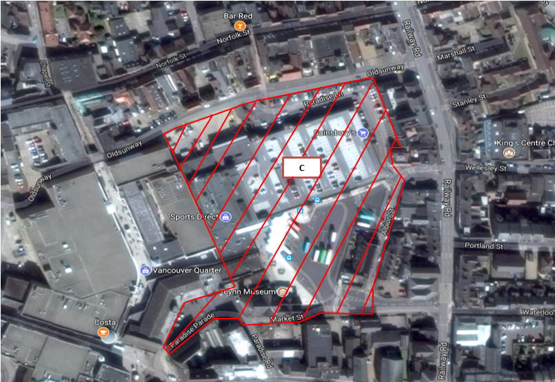 A aerial view of the bus station with an area indicated by red cross-hatching